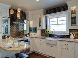 white glass subway tile and cabinet with modern pendant lights