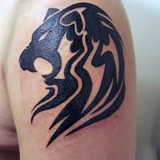 small simple agressive tribal lion mens upper arm tattoo tattoos