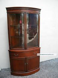 varnished wooden corner display cabinet in mahagony with clear