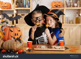 hugging brother sister halloween costumes eating stock photo