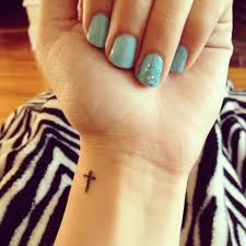 foot cross tattoo nice colour nail polish with one sparkely one and the small and