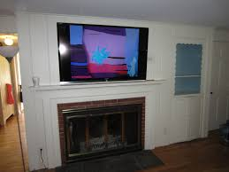 bedroom glamorous tv on fireplace home design ideas picture of