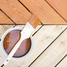 is it better to paint or stain your kitchen cabinets how to stain a wood deck