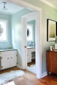 bathroom mirror door framing out a mirror that s mounted on a door young house love