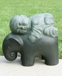 monk and elephant garden statue