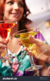martini glasses clinking closeup two clinking martini glasses stock photo 480217075