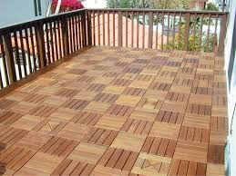 exterior wooden fence with impressive interlocking deck tiles