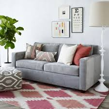 living room with grey sofa and dhurrie rug beautiful dhurrie