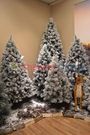 green snow covered tree argos home design and decorating