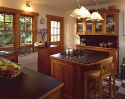 kitchen island small space brown wooden cabinet with black counter top plus brown wooden