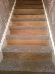 carpet on tread and wood or laminate flooring on the riser this