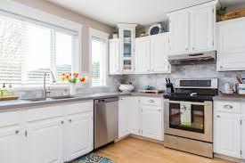 granite countertops off white kitchen cabinets lighting flooring