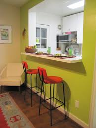 green wall theme connected by double red barstools with black