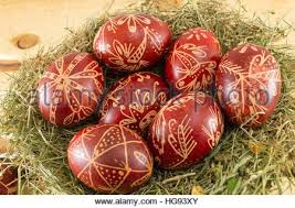 wax easter egg decorating easter eggs decorated with wax and orange flower stock photo