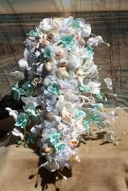aqua and coral handmade seashell flower cascading seashell bouquet