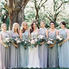 mix and match bridesmaid dresses in shades of blue and grey