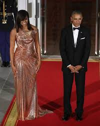 does michelle obama wear hair pieces michelle obama glistens in gold at final state dinner independent ie