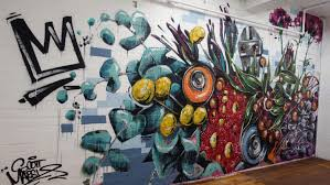 street artist scott marsh goes from graffiti ing train carriages floral mural in an entry foyer in converted warehouse in tempe