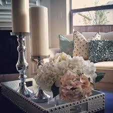 table centerpieces with candles cool white and gold tray filled two tall candle sticks also