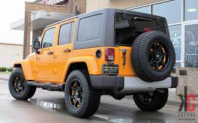 orange jeep wrangler with black rims kc trends showcase 18 moto metal 961 w nitto grappler tires