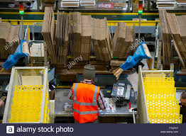 buy on amazon black friday or monday stock pickers in the amazon fulfillment centre warehouse in