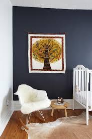 fun boy u0027s nursery design with dark blue accent wall white vintage