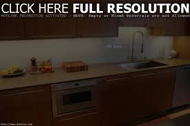 triangular under cabinet lights turn a kitchen cabinet into a flat screen tv cover hgtv