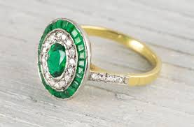 deco emerald diamond and yellow gold engagement ring