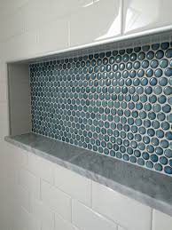 white subway tiles frame gray marble herringbone tiled shower custom shower detail inset niche with penny tiles marble base and subway tile wall