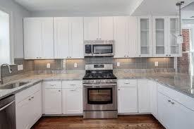 white kitchen cabinets backsplash kitchen attractive white kitchen cabinets with quartz