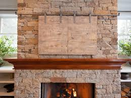barn door over fireplace with tv inviting living room in lake