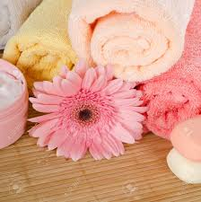 Rug Massage Pink Gerbera And Towel On Bamboo Rug Stock Photo Picture And