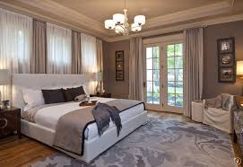 traditional master bedroom with chandelier u0026 crown molding
