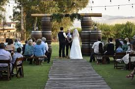 wedding arch log arch ways a rustic affair