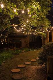 Backyard String Lighting by Round Shaped Pathways And Sparkling Outdoor String Lights For