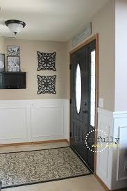 white wainscoting with oak trim dark door love front door