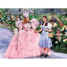 Wizard Of Oz Home Decor by Wizard Of Oz Glinda And Dorothy In Munchkin Land Canvas Art