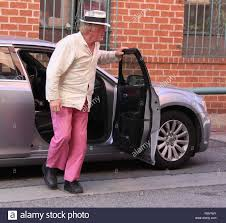 pink and black cars veteren actor nick nolte gets out of his car wearing mismatched
