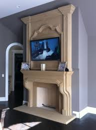 marble subway tile fireplace surround has white molding casing and