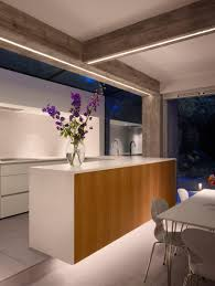 Home Lighting Design London by Paul Archer Uses Board Marked Concrete And Glass For London House