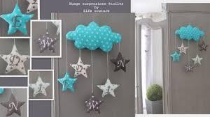 création déco chambre bébé guirlande suspension étoiles nuage goutte turquoise lagon gris