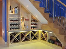 awesome mediterranean wine cellar under half landing staircase of