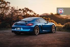 porsche cayman blue porsche cayman gt4 with hre r101 in gloss gold hre performance