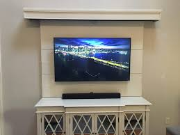 custom entertainment center with pull down movie screen album
