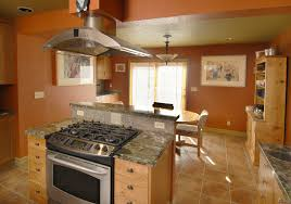 wood countertops kitchen island with stove and oven lighting
