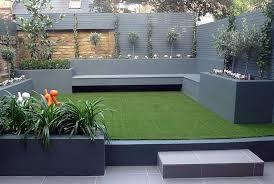 raised beds grey colour scheme artificial grass agapanthus olives