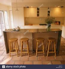 cane stools at breakfast bar on granite topped island unit in