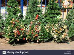 decorated artificial trees kept for sell in front of