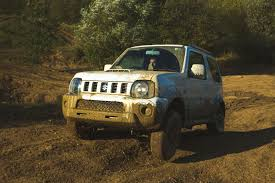 suzuki jimny suzuki jimny vs range rover 15k and 100k off roaders do battle