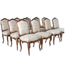 vintage french dining table set of 12 antique french carved fruitwood dining chairs at 1stdibs